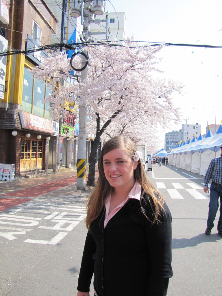 Kimberly poses with some cherry blossoms in her hair