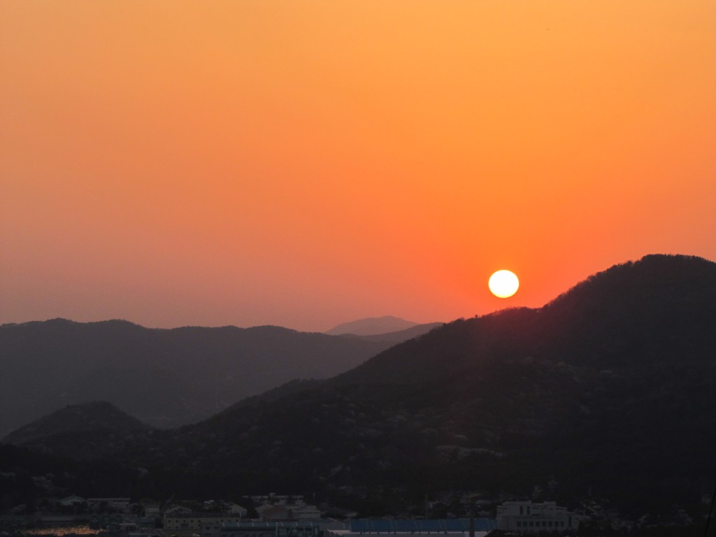 A bright orange sunset over Jinhae in South Korea