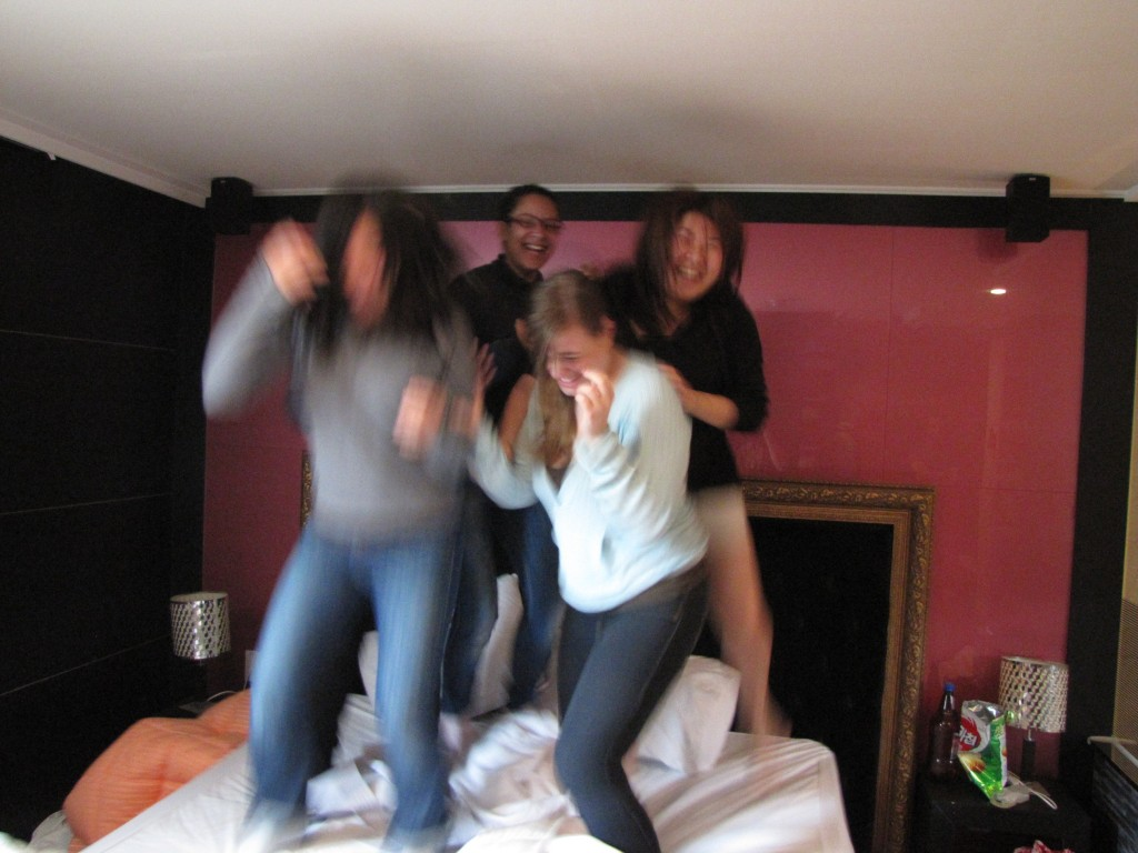 The girls jumping on the bed