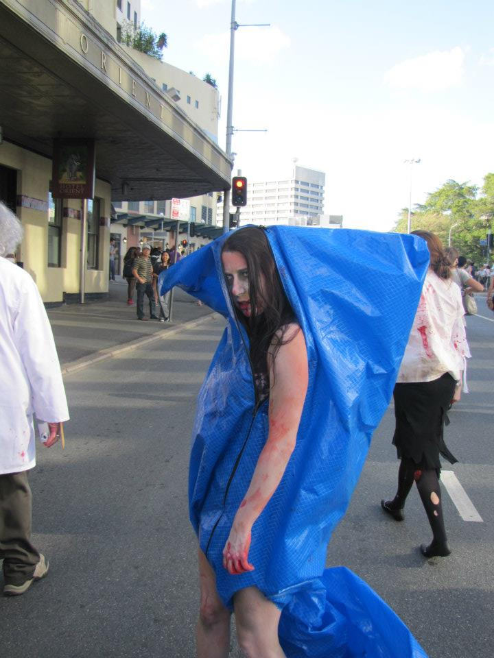 A zombie girl stuck in a tarp