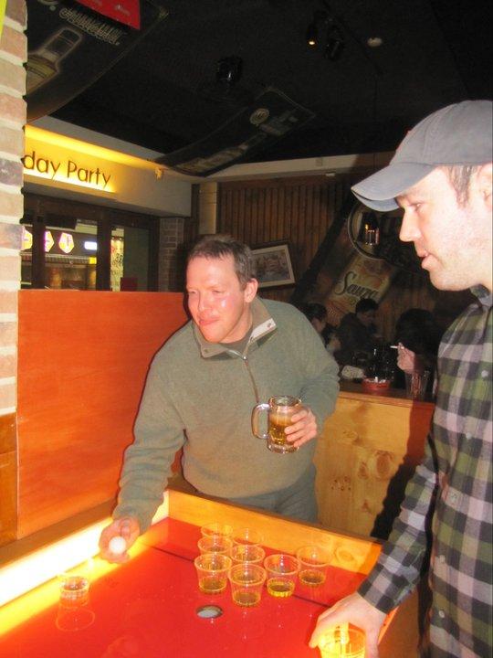 American boys playing beer pong in Korea