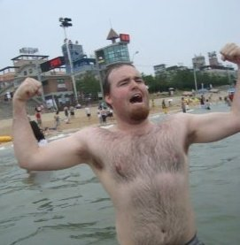 Me roaring with pride on an overcast Korean beach.